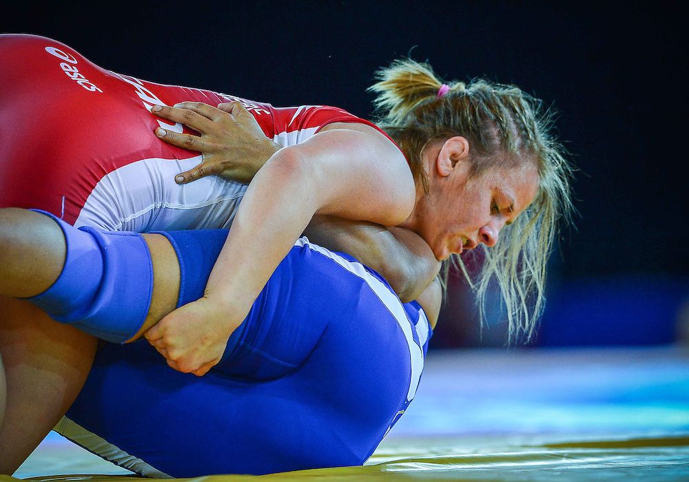 July 29, 2014: Erica Wiebe of Canada (Red) takes on Jyoti of India in the Women's 75kg Nordic Wrestling competition at the Scottish Exhibition Conference Centre during the XX Commonwealth Games in Glasgow, Scotland.