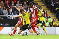Burton Albion midfielder Scott Fraser (7) is fouled by Sunderland midfielder George Honeyman (10)  and Sunderland midfielder Chris Maguire (7)  during the EFL Sky Bet League 1 match between Burton Albion and Sunderland at the Pirelli Stadium, Burton upon Trent, England on 15 September 2018.