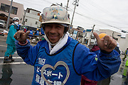 Donald Martin from Guatemala and a Peace boat volunteer taking part in the clean-up operations in Ishinomaki, Miyagi Friday May 6th 2011. Around 350 volunteers took part in the relief effort over the Golden Week holiday, including 41 foreigners, clearing mud and removing debris from this coastal town which more almost levelled in the March 11th earthquake and tsunami.