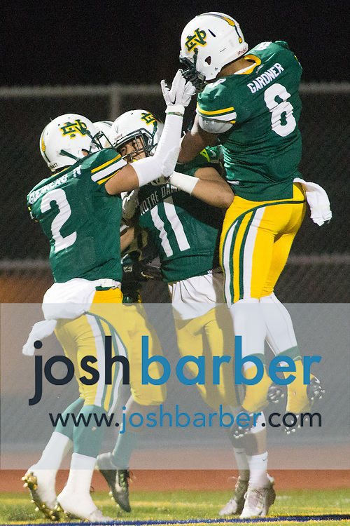 Notre Dame's Manny Guerrero, Lawrence Mai, Jaden Gardner during the CIF-SS Boys Football Northwest Division Semifinal at J.W. North High School on Friday, November 27, 2015 in Riverside, California. (Photo/Josh Barber)