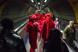 London, UK. 16 October, 2019. Extinction Rebellion's Red Rebel Brigade proceeds to the headquarters of Google and YouTube to take part in International Rebellion Autumn Uprising protests against the 'spread of systematic disinformation on climate change'.