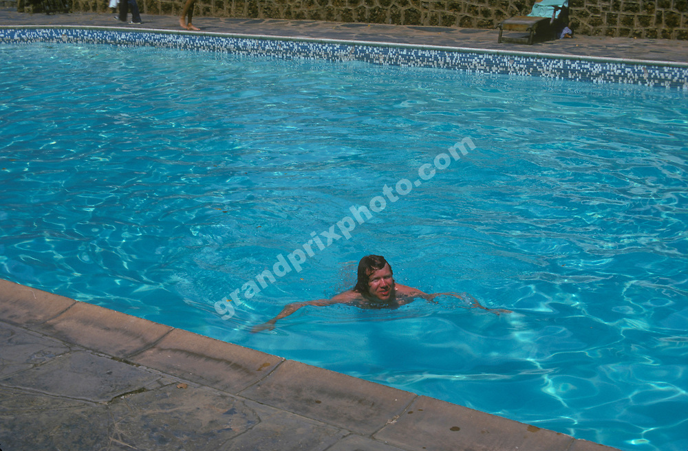 Williams Iso-Ford driver Tom Belso in the swimming pool at the Kyalami Ranch hotel before the 1974 South African Grand Prix in Kyalami. Photo: Grand Prix Photo