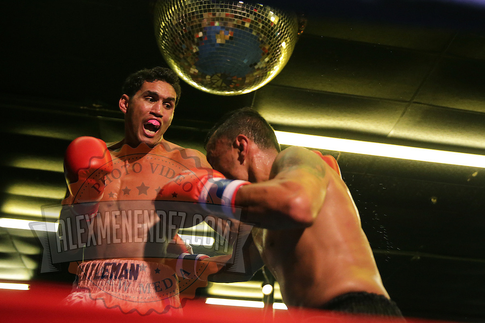 Juan Aguirre fights with Armando Alvarez during the Mad Integrity Fight sports boxing match at the Florida Orange Event Center in Lakeland, Florida on Saturday October 10, 2015. Photo: Alex Menendez