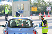 An NHS (National Health Service) worker or care worker is seen arriving at o2 testing Centre for COVID-19 at a drive-through testing centre in a car park at O2 Testing centre in Greenwich, London, Monday, May 4, 2020. <br /> The UK continues in lockdown to help curb the spread of the coronavirus, which has impacted on nations around the globe imposing self-isolation and exercising social distancing when people move from their homes. (Photo/ Vudi Xhymshiti)