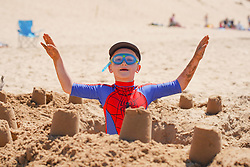 © Licensed to London News Pictures. 12/06/2021.Formby, UK. James Bailes,6, from Liverpool, enjoys the hot weather on Formby beach in Merseyside. Photo credit: Ioannis Alexopoulos/LNP <br /> **Permission Granted