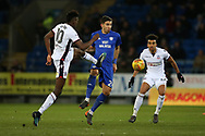 Marko Grujic of Cardiff city © challenges Sammy Ameobi (l) and Derik Osede of Bolton Wanderers ®. EFL Skybet championship match, Cardiff city v Bolton Wanderers at the Cardiff city Stadium in Cardiff, South Wales on Tuesday 13th February 2018.<br /> pic by Andrew Orchard, Andrew Orchard sports photography.