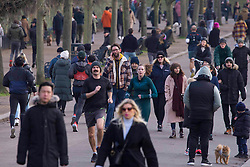 © Licensed to London News Pictures.23/01/2021, London,UK. Members of the public enjoy walking through Victoria Park, east London as the third national lockdown continues. Photo credit: Marcin Nowak/LNP