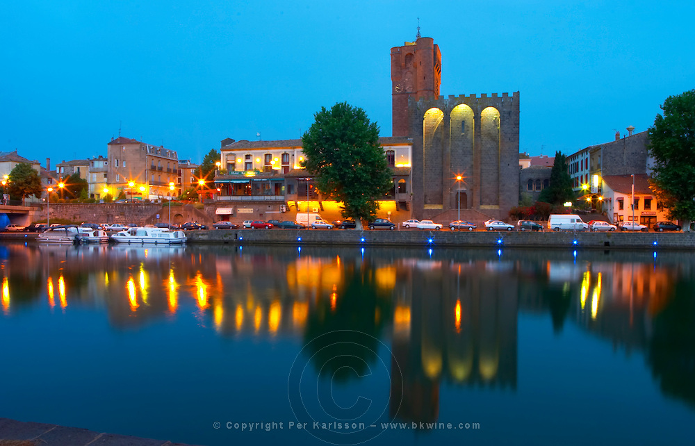 The black basalt lava stone cathedral. The La Galeote hotel. L'Herault river. Agde town. Languedoc. France. Europe. St Etienne cathedral from the 12 century.
