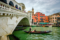 Gondola passing under the Rialto Bridge (Ponte di Rialto) on the Grand Canal in Venice, Italy<br /> <br /> (c) Andrew Wilson | Edinburgh Elite media
