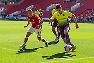 Exeter City's Nigel Atangana (4) defends against Bristol City's Jack Hunt (2) during the EFL Cup match between Bristol City and Exeter City at Ashton Gate, Bristol, England on 5 September 2020.