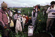 Family and friends bury baby in Llallagua town cemetry,  Bolivia