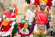 Dancers adjust their headdresses for the Danza de la Pluma, or Dance of the Feather, a traditional Zapotec warrior dance, for the festival of Santiago Matamoros, the patron saint, in front of the monastery and church of Cuilapan, Oaxaca, Mexico on July 25, 2008.