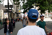 Man wearing a baseball cap embroidered with the logo for Fortnite on 2nd July 2021 in London, United Kingdom. Fortnite is an online video game developed by Epic Games and released in 2017.