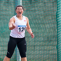 Hannah Lee of Singapore reacts after her throw during the women's discus final of the 17th ASEAN University Games Athletics Championships at the Jakabaring Athletics Stadium on December 15, 2014, in Palembang, Indonesia.