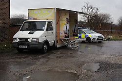 © Licensed to London News Pictures . 15/02/2014 . Oldham , UK . A mobile police station desk has been set up at the scene . Police and crime scene investigators close off an alleyway behind terraces parallel to Ripponden Road this morning (15th February 2014) where it is reported the body of a fifteen year old boy - named locally as Leon Cudworth - was discovered in the early hours . Photo credit : Joel Goodman/LNP