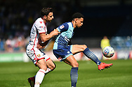 Wycombe Wanderers Nathan Tyson(23) holds off Stevenage's Chris Whelpdale during the EFL Sky Bet League 2 match between Wycombe Wanderers and Stevenage at Adams Park, High Wycombe, England on 5 May 2018. Picture by Alistair Wilson.