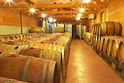 Cave P et Andre Perret in Chavannay, making Condrieu, Saint Joseph, Cote Rotie.  In the winery. In the barrel aging cellar. Oak barrels with agining wine.   Andre André P et A Perret, Chavanay, Rhone, France, Europe