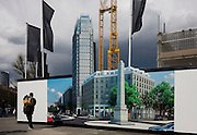 A pedestrian walks past a hoarding showing the future skyscraper being built by housing developer Barratt at Blackfriars Circus at the southern end of Blackfriars Bridge Road, south London borough of Southwark.