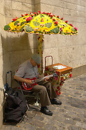 Paris - France - Montmatre - Busker with guitar .<br /> <br /> Visit our FRANCE HISTORIC PLACES PHOTO COLLECTIONS for more photos to download or buy as wall art prints https://funkystock.photoshelter.com/gallery-collection/Pictures-Images-of-France-Photos-of-French-Historic-Landmark-Sites/C0000pDRcOaIqj8E