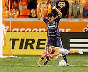 July 3, 2012; Houston, TX, USA; Chicago Fire midfielder Pavel Pardo (17) tackles Houston Dynamo midfielder Brad Davis (11) during the second half at BBVA Compass Stadium. The Fire and Dynamo tied 0-0. Mandatory Credit: Thomas Campbell-US PRESSWIRE
