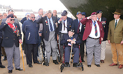 © Licensed to London News Pictures. 06/06/2017. Normandy, France. Former leader of UKIP, NIGEL FARAGE stands with a group of veterans, some who served in WW2 , during a visit to Arromanches Beach in Normandy, France to mark the anniversary of the D-Day landings on June 1944.. Photo credit: Jason Bryant/LNP