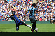 Chelsea midfielder Jorginho (5) performing a sliding tackle on Manchester City Midfielder Leroy Sane (19) during the FA Community Shield match between Chelsea and Manchester City at Wembley Stadium, London, England on 5 August 2018.