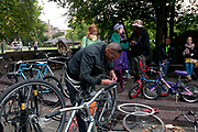 London Fields, Hackney.  Impromptu bicycle repairer.
