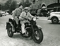 1945 Sidney Skolsky on Schwab's Drugstore's delivery motorcycle