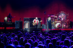 © Licensed to London News Pictures. 27/05/2015. London, UK.  Christine McVie and Stevie Nicks sing duet as Fleetwood Mac performing live at The O2 Arena, together with Christine Mc Vie who has rejoined the band.   In this picture from left - Christine McVie, John MicVie, Steve Nicks, Mick Fleetwood.  The band are due to headline the Isle of Wight Festival next month. Fleetwood Mac are a British-American rock band consisting of members Mick Fleetwood (drums), John McVie (bass guitar), Christine McVie (keyboards/vocals), Lindsey Buckingham (guitars, vocals), Stevie Nicks (vocals, tambourine).  Photo credit : Richard Isaac/LNP