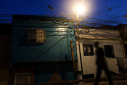 A Night street scene of El Guarataro, a poor hillside slum in western Caracas