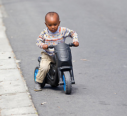 A local biker on King Langalibalele Street during the Open Streets Langa event on 30 October 2016, when the street was closed to motorised vehicles and opened to people. Hosted by Open Streets Cape Town and supported by the City of Cape town and WWF. photo by John Tee/RealTime Images.