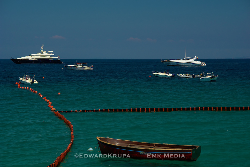 Boats anchored off of the resort Island of Capri in the Gulf of Naples part of the Tyrrhenian Sea, Italy.