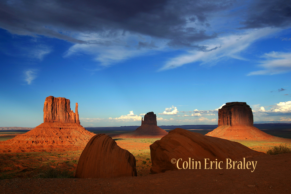 Clouds cast shadows in Monument Valley, which lies within the range of Utah's Navajo Nation Reservation. The area was a favorite for filmmaker John Ford with his westerns starring John Wayne.