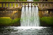 waterfall through a wall railing at the Cushman Power Generator station at the Hood Canal Tacoma City Light Hoodsport, Washington, USA