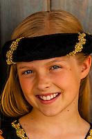 Preteen girl dressed in medieval costume, Cedar City, Utah USA. Cedar City is home to the Tony Award-winning Utah Shakespeare Festival.