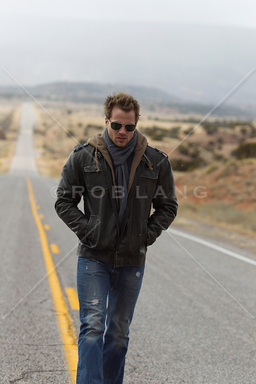 man walking in the middle of a road in New Mexico