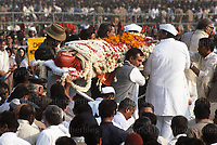 Indian Prime Miniser Indira Gandi assasinated by her bodyguards.Her body is lifted on to the traditional funeral pyre at Raj Ghat, New Delhi in November 1984. Photograph by Jayne Fincher