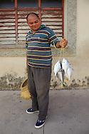 Man with fish in Gibara, Holguin, Cuba.