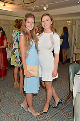 Left to right, KATIE READMAN and ZENOUSKA MOWATT at a breakfast hosted by Halcyon Days at Fortnum & Mason, 181 Piccadilly, London on 8th July 2014.