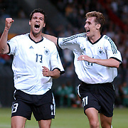 l-r; Germany's Michael Ballack celebrates scoring their third goal with Hat-trick man Miroslav Klose