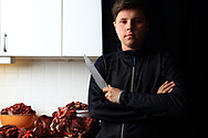 Mathis Eira, 16 years old, butchers meat from family reindeer herd in mother's kitchen. He is presently a full-time student in Reindeer School.