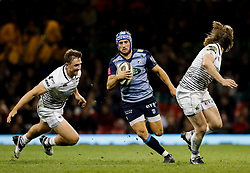 Cardiff Blues' Matthew Morgan evades the tackle of Ospreys' Ashley Beck<br /> <br /> Photographer Simon King/Replay Images<br /> <br /> Guinness PRO14 Round 21 - Cardiff Blues v Ospreys - Saturday 28th April 2018 - Principality Stadium - Cardiff<br /> <br /> World Copyright © Replay Images . All rights reserved. info@replayimages.co.uk - http://replayimages.co.uk