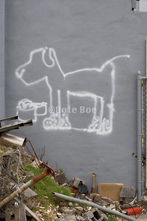 funny dog graffiti on the side of a building