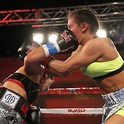 Noemi Bosques (L) catches Nydia Feliciano with an overhand right to the face during a Telemundo Boxeo boxing match at the A La Carte Pavilion on Friday,  March 13, 2015 in Tampa, Florida.  Feliciano won the bout by split decision. (AP Photo/Alex Menendez)
