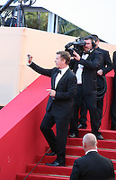 Actor Alec Baldwin photographs the crowd outside the Mud gala screening at the 65th Cannes Film Festival France. Saturday 26th May 2012 in Cannes Film Festival, France.