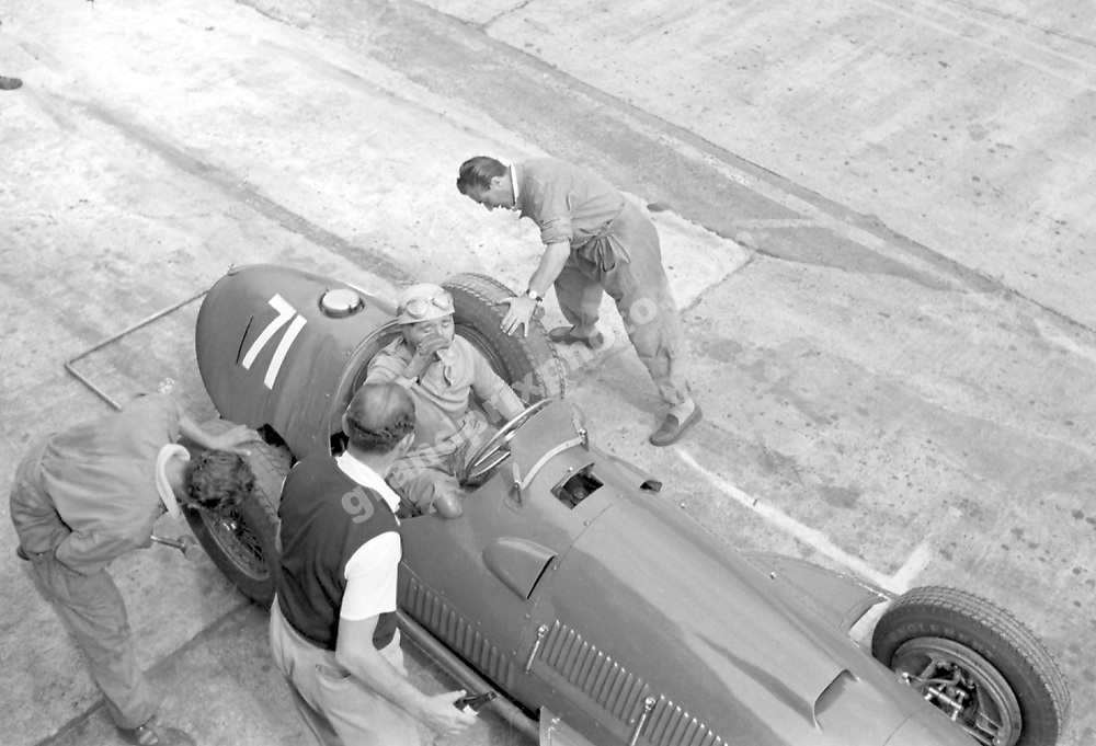 Alberto Ascari (Ferrari) with a drink during a pit-stop in the 1951 German Grand Prix at the Nurburgring. Photo: Grand Prix Photo