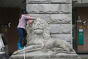 Cleaning lion with surveillance cameras behind, hoitel Shanghai