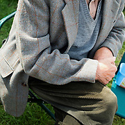 A farmer wearing a tweed jacket and green corduroy trousers at Danby Show on 10th August 2016 in North Yorkshire, United Kingdom.
