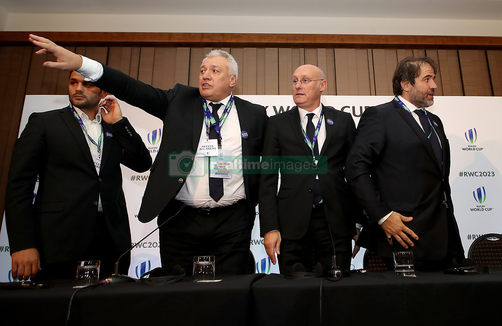 France 2023 bid president Claude Atcher (second left), French Rugby Federation president Bernard Laporte (second right) and Serge Simon (right) during the 2023 Rugby World Cup host union announcement at The Royal Garden Hotel, Kensington. PRESS ASSOCIATION Photo. Picture date: Wednesday November 15, 2017. Photo credit should read: John Walton/PA Wire. RESTRICTIONS: Editorial use only. No commercial use without prior permission.