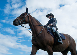 © Licensed to London News Pictures. <br /> 13/08/2014. <br /> <br /> Danby, North Yorkshire, United Kingdom<br /> <br /> A young rider walks her horse around the practice ring prior to her heat at the Danby Agricultural Show in North Yorkshire. <br /> <br /> This year is the 154th show which was founded in 1848. It is the oldest agricultural show in the area and offers sheep dog trials, judging of a variety of different animals such as cattle, sheep, ferrets, horses and rabbits along with different classes of horticulture and dairy. <br /> <br /> Photo credit : Ian Forsyth/LNP